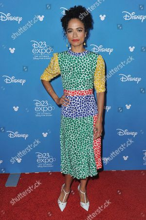 Stock Image of Lauren Ridloff attends the Go Behind the Scenes with the Walt Disney Studios press line at the 2019 D23 Expo, in Anaheim, Calif