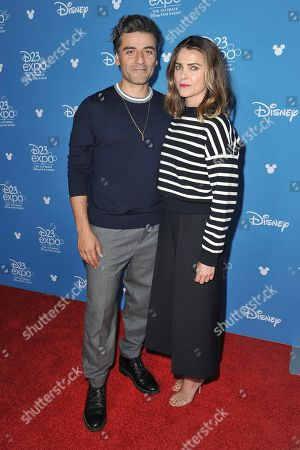 """Oscar Isaac, Keri Russell. Oscar Isaac, left, and Keri Russell attend """"Go Behind the Scenes with the Walt Disney Studios"""" press line at the 2019 D23 Expo, in Anaheim, Calif"""