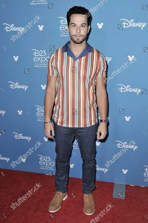 """Skylar Astin attends """"Go Behind the Scenes with the Walt Disney Studios"""" press line at the 2019 D23 Expo, in Anaheim, Calif"""
