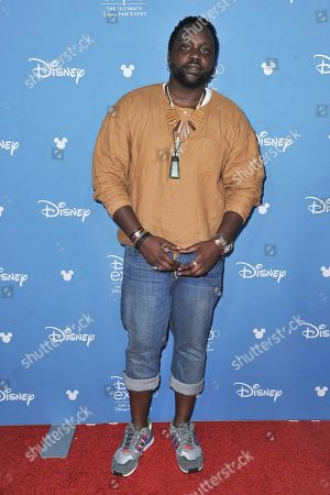 "Stock Photo of Brian Tyree Henry attends ""Go Behind the Scenes with the Walt Disney Studios"" press line at the 2019 D23 Expo, in Anaheim, Calif"