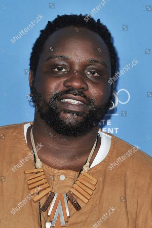 "Brian Tyree Henry attends ""Go Behind the Scenes with the Walt Disney Studios"" press line at the 2019 D23 Expo, in Anaheim, Calif"