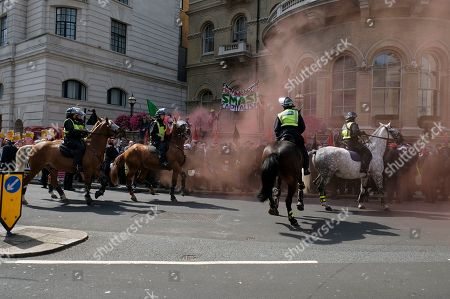 Policemen on horses surround the anti fascism protesters during the rally. Supporters gathered outside BBC to demand the freedom of their jailed right-wing leader Tommy Robinson aka Tommy Robinson. During the rally, police had to intervene and raise their batons when a Police van was attacked by the Tommy Robinson supporters. A person was arrested after the confrontation.