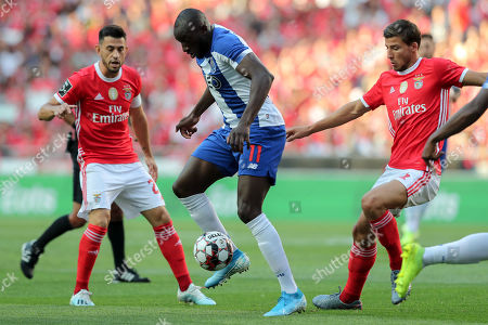 Benfica's player Ruben Dias (R) and Pizzi (L) in action against FC Porto's player Moussa Marega (C) during their Portuguese First League soccer match held at Luz stadium in Lisbon, Portugal, 24 August 2019.