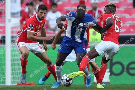 Benfica's player Ruben Dias (L) and Florentino (R) in action against FC Porto's player Moussa Marega (C) during their Portuguese First League soccer match held at Luz stadium in Lisbon, Portugal, 24 August 2019.