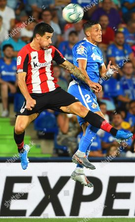 Getafe's Faycal Fajr (R) in action against Bilbao's Yuri Berchiche (L) during the Spanish La Liga soccer match between Getafe CF and Athletic Bilbao in Madrid, Spain, 24 August 2019.