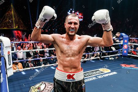Sergey Kovalev of Russia celebrates after defeating Anthony Yarde of Britain during their WBO light heavyweight title bout in Chelyabinsk, Russia