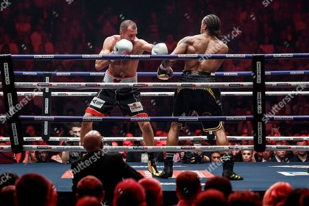 Anthony Yarde, Sergey Kovalev. Boxers Anthony Yarde of Britain right, and Sergey Kovalev of Russia exchange blows during their WBO light heavyweight title bout in Chelyabinsk, Russia