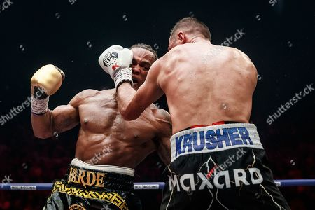 Anthony Yarde, Sergey Kovalev. Boxers Anthony Yarde of Britain, left, punches Sergey Kovalev of Russia during their WBO light heavyweight title bout in Chelyabinsk, Russia