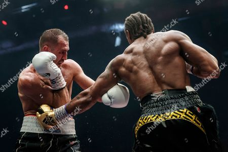 Anthony Yarde, Sergey Kovalev. Boxers Anthony Yarde of Britain right, punches Sergey Kovalev of Russia during their WBO light heavyweight title bout in Chelyabinsk, Russia