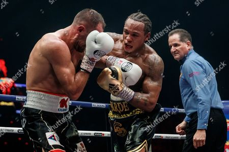 Anthony Yarde, Sergey Kovalev. Boxers Anthony Yarde of Britain, right, punches Sergey Kovalev of Russia during their WBO light heavyweight title bout in Chelyabinsk, Russia