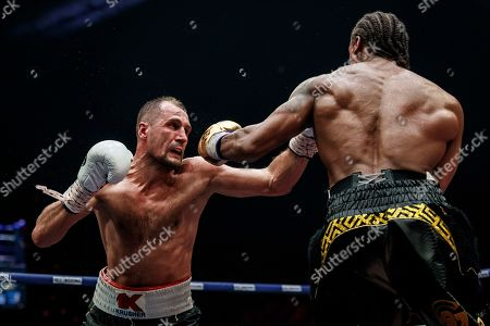 Stock Image of Anthony Yarde, Sergey Kovalev. Boxers Anthony Yarde of Britain, right, and Sergey Kovalev of Russia exchange blows during their WBO light heavyweight title bout in Chelyabinsk, Russia