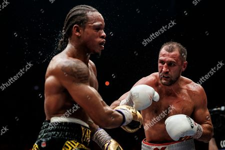 Anthony Yarde, Sergey Kovalev. Boxers Sergey Kovalev of Russia, right, and Anthony Yarde of Britain exchange blows during their WBO light heavyweight title bout in Chelyabinsk, Russia