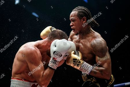 Stock Picture of Anthony Yarde, Sergey Kovalev. Boxers Anthony Yarde of Britain, right, punches Sergey Kovalev of Russia during their WBO light heavyweight title bout in Chelyabinsk, Russia