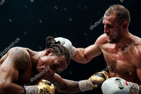 Anthony Yarde, Sergey Kovalev. Boxers Anthony Yarde of Britain, left, and Sergey Kovalev of Russia exchange blows during their WBO light heavyweight title bout in Chelyabinsk, Russia