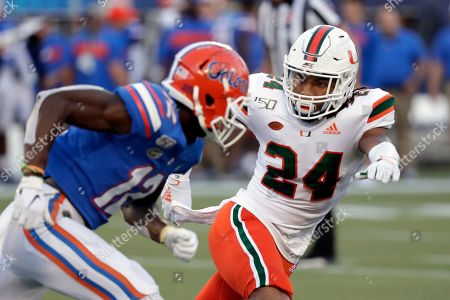 Miami cornerback Christian Williams (24) covers Florida wide receiver Van Jefferson on a pass pattern during the first half of an NCAA college football game, in Orlando, Fla