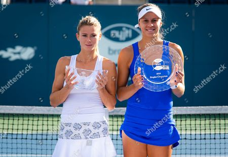 Camila Giorgi of Italy and Magda Linette of Poland during the trophy ceremony