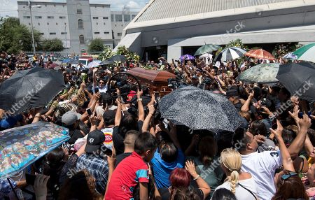 Stock Picture of Friends, relatives, and fans give farewell to Celso Pina during his funeral and tribute at the Guadalupe Basilica, in Monterrey, Mexico, 24 August 2019. The Mexican accordionist died on 21 August at age 66. The City Council of Monterrey will raise a statue to the musician and it will place his name on a street.
