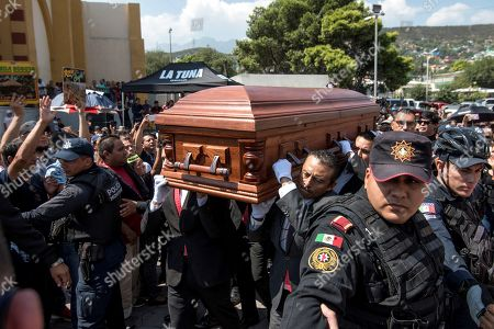 Stock Photo of Friends, relatives, and fans give farewell to Celso Pina during his funeral and tribute at the Guadalupe Basilica, in Monterrey, Mexico, 24 August 2019. The Mexican accordionist died on 21 August at age 66. The City Council of Monterrey will raise a statue to the musician and it will place his name on a street.