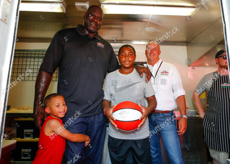 Papa John's CEO Steve Ritchie and Board Member Shaquille O'Neal with young guests at the Atlanta Block Party in Atlanta
