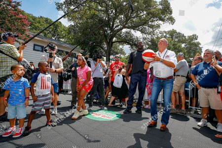 Stock Picture of Papa John's CEO Steve Ritchie and Board Member Shaquille O'Neal shooting hoops in Atlanta in Atlanta