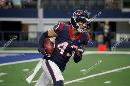 Stock Photo of Houston Texans safety Chris Johnson (43) warms up before a preseason NFL football game against the Dallas Cowboys in Arlington, Texas