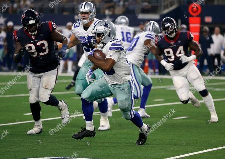 Darian Thompson, Joel Heath, Charles Omenihu. Dallas Cowboys defensive back Darian Thompson (23) carries the ball as Houston Texans' Joel Heath (93) and Charles Omenihu (94) give chase during a preseason NFL football game in Arlington, Texas