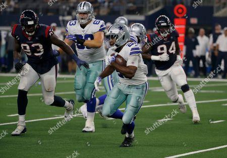 Stock Picture of Darian Thompson, Joel Heath, Charles Omenihu. Dallas Cowboys defensive back Darian Thompson (23) carries the ball as Houston Texans' Joel Heath (93) and Charles Omenihu (94) give chase during a preseason NFL football game in Arlington, Texas