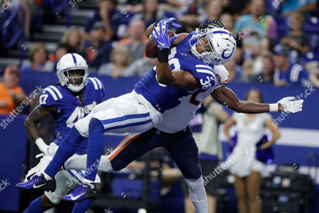 Indianapolis Colts defensive back Isaiah Johnson (38) makes an interception next to Chicago Bears wide receiver Joe Walker (2) during the second half of an NFL preseason football game, in Indianapolis
