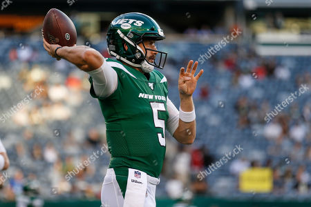 New York Jets quarterback Davis Webb (5) warms up before a preseason NFL football game against the New Orleans Saints, in East Rutherford, N.J