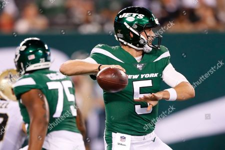 New York Jets quarterback Davis Webb (5) throws a pass during the second half of a preseason NFL football game against the New Orleans Saints, in East Rutherford, N.J