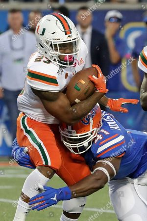 Cam'Ron Harris, James Houston IV. Miami running back Cam'Ron Harris, left, is stopped by Florida linebacker James Houston IV on a run during the first half of an NCAA college football game, in Orlando, Fla