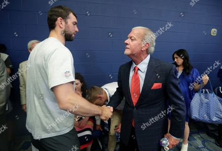Indianapolis Colts quarterback Andrew Luck shakes hands with Indianapolis Colts owner Jim Irsay after a news conference following the team's NFL preseason football game against the Chicago Bears, in Indianapolis. The oft-injured star is retiring at age 29