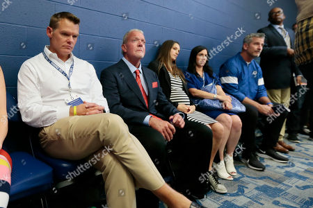 Indianapolis Colts general manager Chris Ballard, left, and owner Jim Irsay, second from left, listen as Colts quarterback Andrew Luck speaks during a news conference following the team's NFL preseason football game against the Chicago Bears, in Indianapolis. The oft-injured star is retiring at age 29
