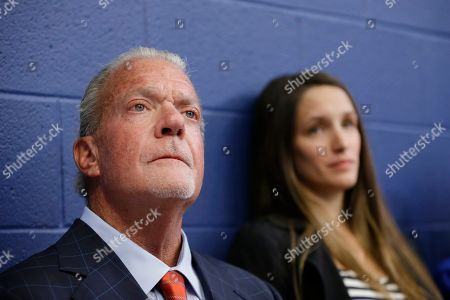 Indianapolis Colts owner Jim Irsay listens as Colts quarterback Andrew Luck speaks during a news conference following the team's NFL preseason football game against the Chicago Bears, in Indianapolis. The oft-injured star is retiring at age 29