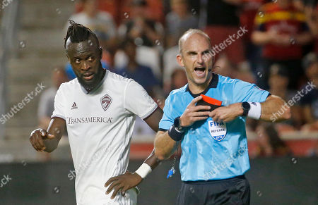 Colorado Rapids forward Kei Kamara, left, looks at the official who had issued Kamara a red card during the second half of the team's MLS soccer match against Real Salt Lake, in Sandy, Utah