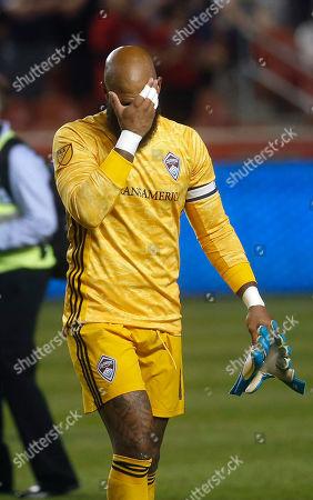 Colorado Rapids goalkeeper Tim Howard walks off the field following the team's MLS soccer match against Real Salt Lake, in Sandy, Utah