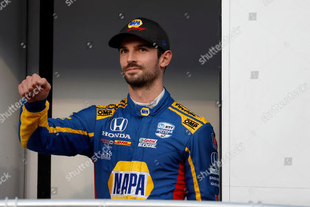 Alexander Rossi waves before the IndyCar auto race at World Wide Technology Raceway, in Madison, Ill