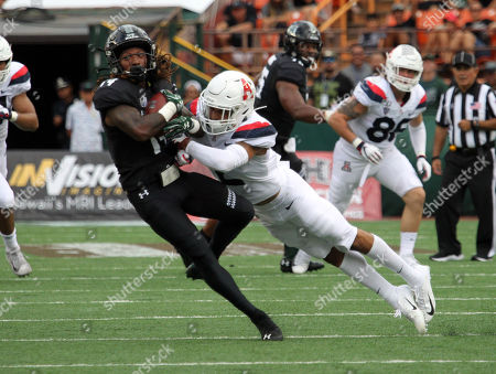 Hawaii Rainbow Warriors wide receiver James Phillips #14 gets taken down by Arizona Wildcats cornerback Lorenzo Burns #2 after a catch during the game between the Hawaii Rainbow Warriors and the Arizona Wildcats at Aloha Stadium in Honolulu, HI - Michael Sullivan/CSM