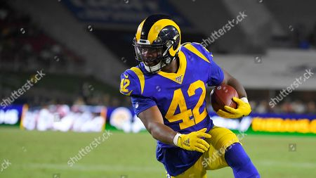 Los Angeles Rams running back John Kelly runs the ball during the second half of an NFL football game against the Denver Broncos, in Los Angeles