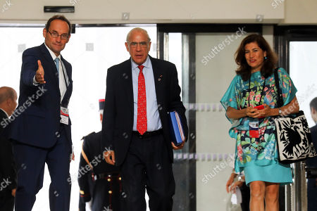 The Organisation for Economic Co-operation and Development (OECD) Secretary General Jose Angel Gurria (C) is welcomed as he arrives for the G7 Summit in Biarritz, France, 25 August 2019. The G7 Summit runs from 24 to 26 August in Biarritz.