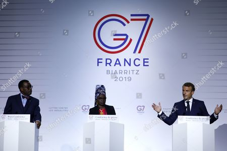 French President Emmanuel Macron (R), African Development Bank President Akinwumi Adesina (L)  and UNICEF ambassador Angelique Kidjo  (C) speak during a press conference on the AWAFA (Affirmative Finance Action for Women in Africa) program during the G7 summit in Biarritz, France, 25 August 2019. The G7 Summit runs from 24 to 26 August in Biarritz.
