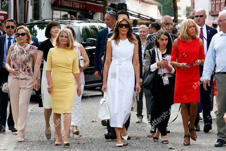 Brigitte Macron (R), wife of French President Emmanuel Macron, U.S. First Lady Melania Trump (C), Akie Abe (2-L), wife of Japan's Prime Minister Shinzo Abe, Chile's First Lady Cecilia Morel (L), Malgorzata Tusk (3-L), wife of European Council President Donald Tusk wlak in the streets during a visit on traditional Basque culture as part of the G7 summit, in Espelette, near Biarritz, France, 25 August 2019. The G7 Summit runs from 24 to 26 August in Biarritz.