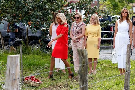 Brigitte Macron (3L), wife of French President Emmanuel Macron, U.S. First Lady Melania Trump (R), Chile's First Lady Cecilia Morel (2-L), Malgorzata Tusk (2-R), wife of European Council President Donald Tusk pose in a field of Espelette pepper during a visit on traditional Basque culture as part of the G7 summit, in Espelette, near Biarritz, France, 25 August 2019. The G7 Summit runs from 24 to 26 August in Biarritz.