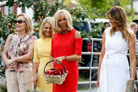 Brigitte Macron (2-R), wife of French President Emmanuel Macron, U.S. First Lady Melania Trump (R), Chile's First Lady Cecilia Morel (L), Malgorzata Tusk (2-L), wife of European Council President Donald Tusk pose in a field of Espelette pepper during a visit on traditional Basque culture as part of the G7 summit, in Espelette, near Biarritz, France, 25 August 2019. The G7 Summit runs from 24 to 26 August in Biarritz.