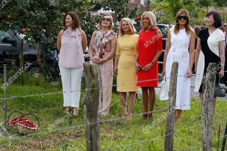 Brigitte Macron (3-R), wife of French President Emmanuel Macron, U.S. First Lady Melania Trump (2-R), Akie Abe (R), wife of Japan's Prime Minister Shinzo Abe, Chile's First Lady Cecilia Morel (2-L), Jenny Morrison (L), wife of Australia's Prime Minister Scott Morrison, Malgorzata Tusk (3-L), wife of European Council President Donald Tusk pose in a field of Espelette pepper during a visit on traditional Basque culture as part of the G7 summit, in Espelette, near Biarritz, France, 25 August 2019. The G7 Summit runs from 24 to 26 August in Biarritz.