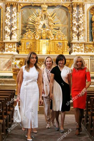 Brigitte Macron (R), wife of French President Emmanuel Macron, U.S. First Lady Melania Trump (L), Akie Abe (2-R), wife of Japan's Prime Minister Shinzo Abe and Chile's First Lady Cecilia Morel (2-L) visit a church during a visit on traditional Basque culture as part of the G7 summit, in Espelette, near Biarritz, France, 25 August 2019. The G7 Summit runs from 24 to 26 August in Biarritz.