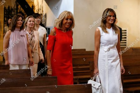 Brigitte Macron (2-R), wife of French President Emmanuel Macron, U.S. First Lady Melania Trump (R), Akie Abe (3-L), wife of Japan's Prime Minister Shinzo Abe, Chile's First Lady Cecilia Morel (2-L), Jenny Morrison (L), wife of Australia's Prime Minister Scott Morrison visit a church during a visit on traditional Basque culture as part of the G7 summit, in Espelette, near Biarritz, France, 25 August 2019. The G7 Summit runs from 24 to 26 August in Biarritz.