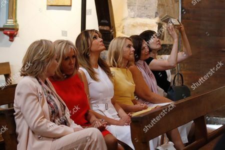 Brigitte Macron (2-L), wife of French President Emmanuel Macron, U.S. First Lady Melania Trump (3-L), Akie Abe (R), wife of Japan's Prime Minister Shinzo Abe, Chile's First Lady Cecilia Morel (L), Jenny Morrison (2-R), wife of Australia's Prime Minister Scott Morrison, and Malgorzata Tusk (3-R), wife of European Council President Donald Tusk visit a church during a visit on traditional Basque culture as part of the G7 summit, in Espelette, near Biarritz, France, 25 August 2019. The G7 Summit runs from 24 to 26 August in Biarritz.