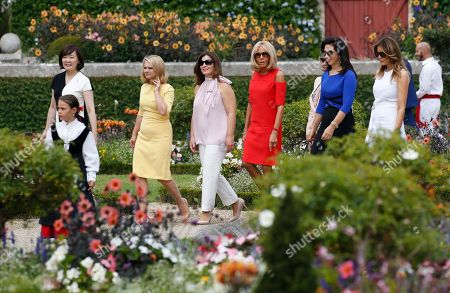 Brigitte Macron (3-R), wife of French President Emmanuel Macron, U.S. First Lady Melania Trump (R), Akie Abe (L), wife of Japan's Prime Minister Shinzo Abe, Jenny Morrison (3-L), wife of Australia's Prime Minister Scott Morrison, Malgorzata Tusk (2-L), wife of European Council President Donald Tusk and Adele Malpass (2-R), wife of World Bank President David Malpass walk in the garden of the Villa Arnaga, House-museum of Edmond Rostand during a tour on a traditional Basque culture as part of the G7 summit, in Espelette, near Biarritz, France, 25 August  2019.  The G7 Summit runs from 24 to 26 August in Biarritz.