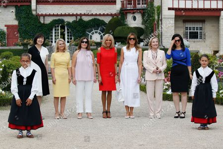 Brigitte Macron (C), wife of French President Emmanuel Macron, U.S. First Lady Melania Trump (3-R), Akie Abe (L), wife of Japan's Prime Minister Shinzo Abe, Chile's First Lady Cecilia Morel (2-R), Jenny Morrison (3-L), wife of Australia's Prime Minister Scott Morrison, Malgorzata Tusk (2-L), wife of European Council President Donald Tusk and Adele Malpass (R), wife of World Bank President David Malpass pose in the garden of the Villa Arnaga, House-museum of Edmond Rostand during a tour on a traditional Basque culture as part of the G7 summit, in Espelette, near Biarritz, France, 25 August  2019.  The G7 Summit runs from 24 to 26 August in Biarritz.